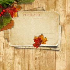 Free Autumn Leaves Over Wooden Background With Postcard Stock Photo - 33707510