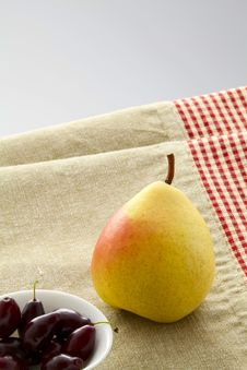 Ripe Pear And Dogwood Royalty Free Stock Photo