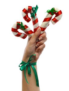 Free Hand With Christmas Canes 2 Royalty Free Stock Photos - 33715378