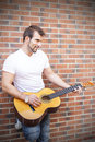 Free Artist Playing Guitar. Royalty Free Stock Photography - 33727927