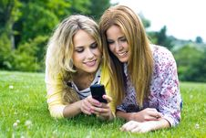 Free Two Sisters With Smartphone At The Park Stock Image - 33723071