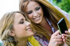 Free Two Sisters With Smartphone At The Park Royalty Free Stock Photo - 33723495