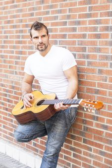 Free Street Musician With Cflassic Guitar. Royalty Free Stock Images - 33727339