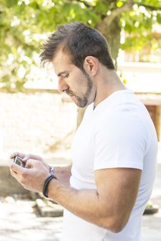 Free Man Playing On Phone. Royalty Free Stock Photography - 33727697
