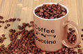 Free Brown Cup With Coffee Beans Is On A Wooden Table Royalty Free Stock Photos - 33736588