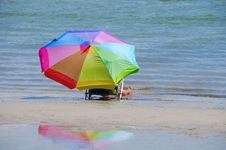 Free Woman And Colorful Umbrella By The Shoreline Stock Photo - 33744120