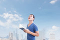 Free Man With Book Looking Up Above Stock Images - 33766454