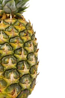 Pineapple Is Located Half Of A White Background Royalty Free Stock Photo