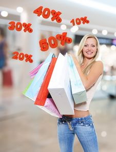 Free Woman With Shopping Bags Poses At Store Royalty Free Stock Photos - 33774638