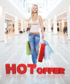Free Woman With Shopping Bags Poses At Store Stock Photography - 33774672
