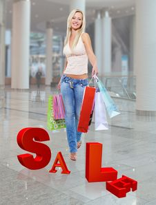 Free Woman With Shopping Bags Poses At Store Stock Photos - 33774673