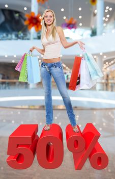 Free Woman With Shopping Bags Poses At Store Stock Images - 33774674
