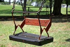 Free Swing In Green Playground Stock Image - 3383511