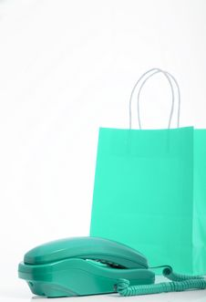 Telephone And Shopping Bag Royalty Free Stock Photo