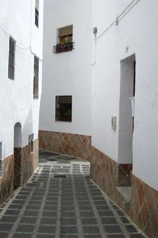 Moorish Street With Homes And Cobbles, Andalusia Stock Images