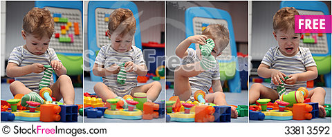 Free A Funny Baby Boy Trying To Dress Socks Stock Photography - 33813592