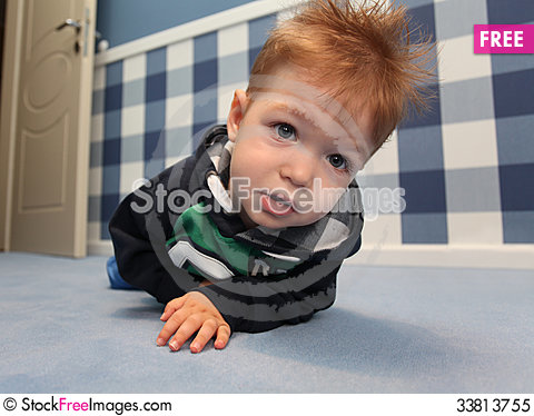 Free A Curious Baby Boy Lying On A Floor In Room Royalty Free Stock Photo - 33813755