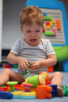A Baby Boy Crying In Children Room