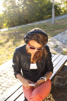 Young Woman Enjoying Music Royalty Free Stock Images