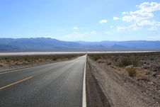 Straight Road Through The Desert, California, USA Stock Photography