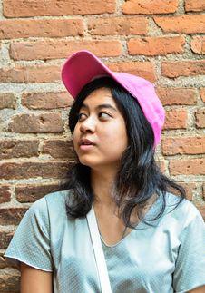 Free Asian Girl Over Brick Wall Royalty Free Stock Image - 33827686
