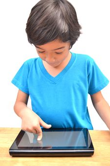 Free Little Boy Using Tablet Stock Image - 33844021