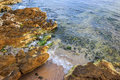 Free Seabed Seen Through Clear Waves Crashing Stones On Shore Royalty Free Stock Images - 33852429
