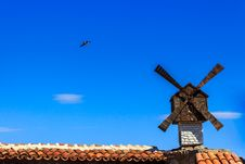 Free Windmill And Seagul On Background Of Blue Sky Over Building Royalty Free Stock Image - 33850826