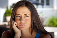 Free Portrait Of A Pretty Sad Young Woman Stock Image - 33858121