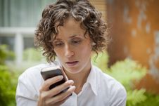 Free Woman Receiving Bad News On The Phone Stock Photography - 33858582