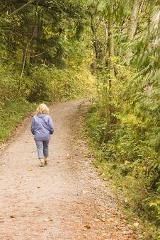 Free Woman Walking Through Woods Stock Images - 3391554