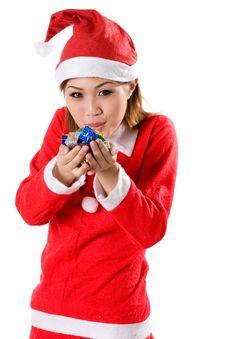 Cute Santa Blowing Tiny Gifts Stock Image