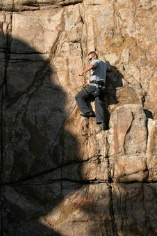 Free Climber On The Edge Of Shadow Stock Images - 3395914