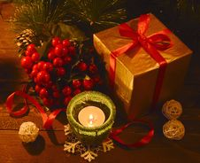 Golden Box With Ilex And Candle Royalty Free Stock Image