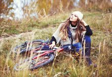 Free Woman Cyclist Relaxing In Autumn Park Stock Photos - 33920103