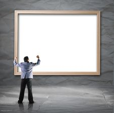 Free Businessman Looking For White Backdrop With Wooden Frame Stock Photo - 33949250
