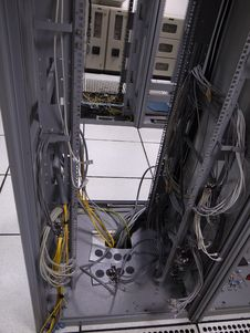 Free Old Data Center Rack With Left Behind Cables Stock Photography - 33958162