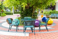 Free Outdoor Chair In The Garden Stock Image - 33983771