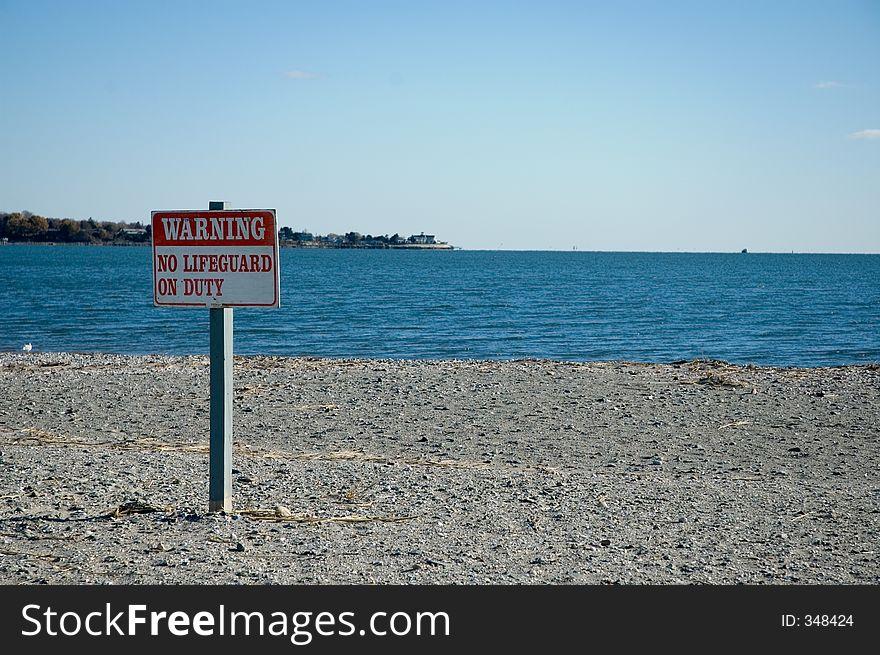 Warning, No Lifeguard On Duty Sign at the Beach