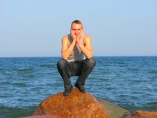 Free Young Man Sitting On A Stone Stock Photography - 3400402
