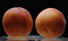 Two Wet Peaches Stock Photos