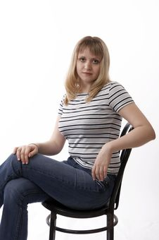 Woman Sitting On A Chair Stock Image