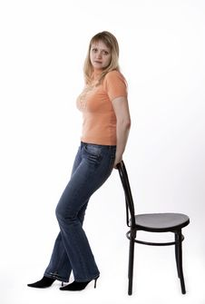 Free Woman Standing By A Chair Stock Photo - 3406320