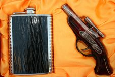 Pistol And Flask Royalty Free Stock Photography