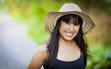 Free Spanish Girl With A Hat Smiling At The Park Stock Photography - 34001942
