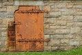 Free Rustic Metal Door In Stone Wall Stock Photo - 34023320