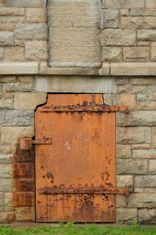 Rustic Metal Door In Stone Wall Royalty Free Stock Photos