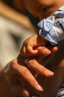 Baby Holding Mother Finger Royalty Free Stock Photography