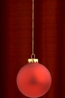 Free Red Christmas Ornament On A Burgundy Background Stock Photos - 3410723