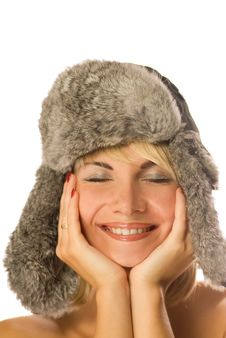 Girl In Winter Fur-cap Royalty Free Stock Photos